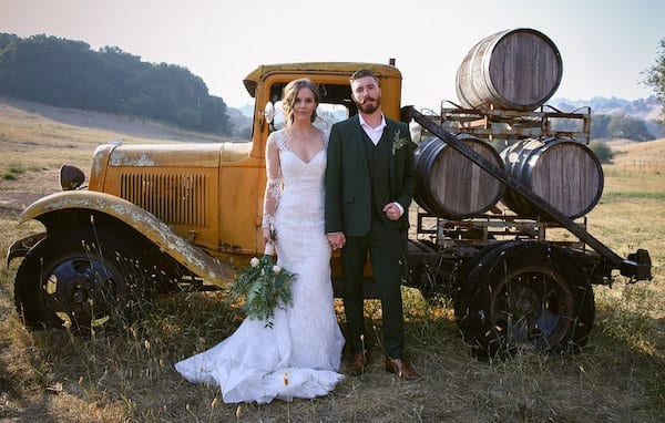 Mountain House Estate – Wine Country Wedding – California wine country weddings – Bay Area weddings - bride and groom in front of truck with wine barrels