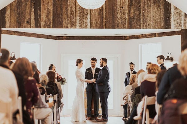 6 Mountain House Estate – Wine country winter wedding – Mountain House Estate wedding exchanging wedding vows indoor wedding ceremony