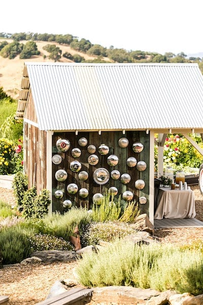 rustic garden shed - vintage hubcap collection - Mountina House Estate - San Francisco bay rustic wedding venue