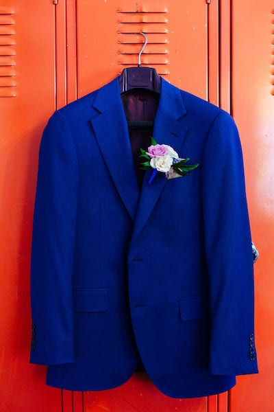 Groom - Navy Blue Suit - colorful boutonniere - Mountain House Estate ready room
