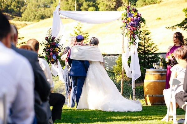 Mountain House Estate - Mountain House Estate Jewish wedding ceremony - bride and groom under chuppah- bride and groom wrapped in tallit