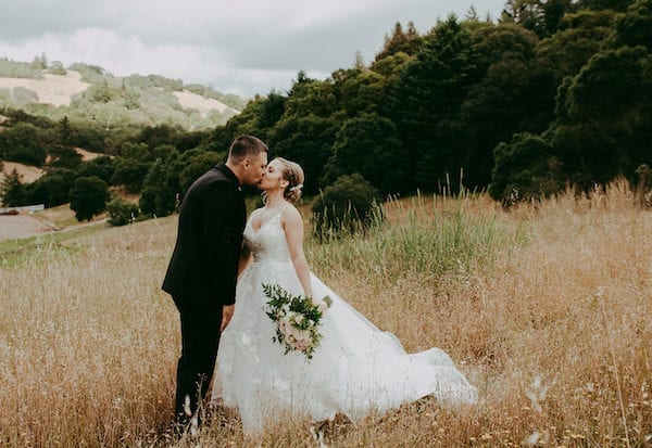 Mountain House Estate – pink and white wedding – wine country wedding- California wine country rustic wedding venue - bride and groom in a field - bride - groom