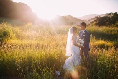 Mountain House Estate - California Wine Country Weddings - bride and groom in field at sunset